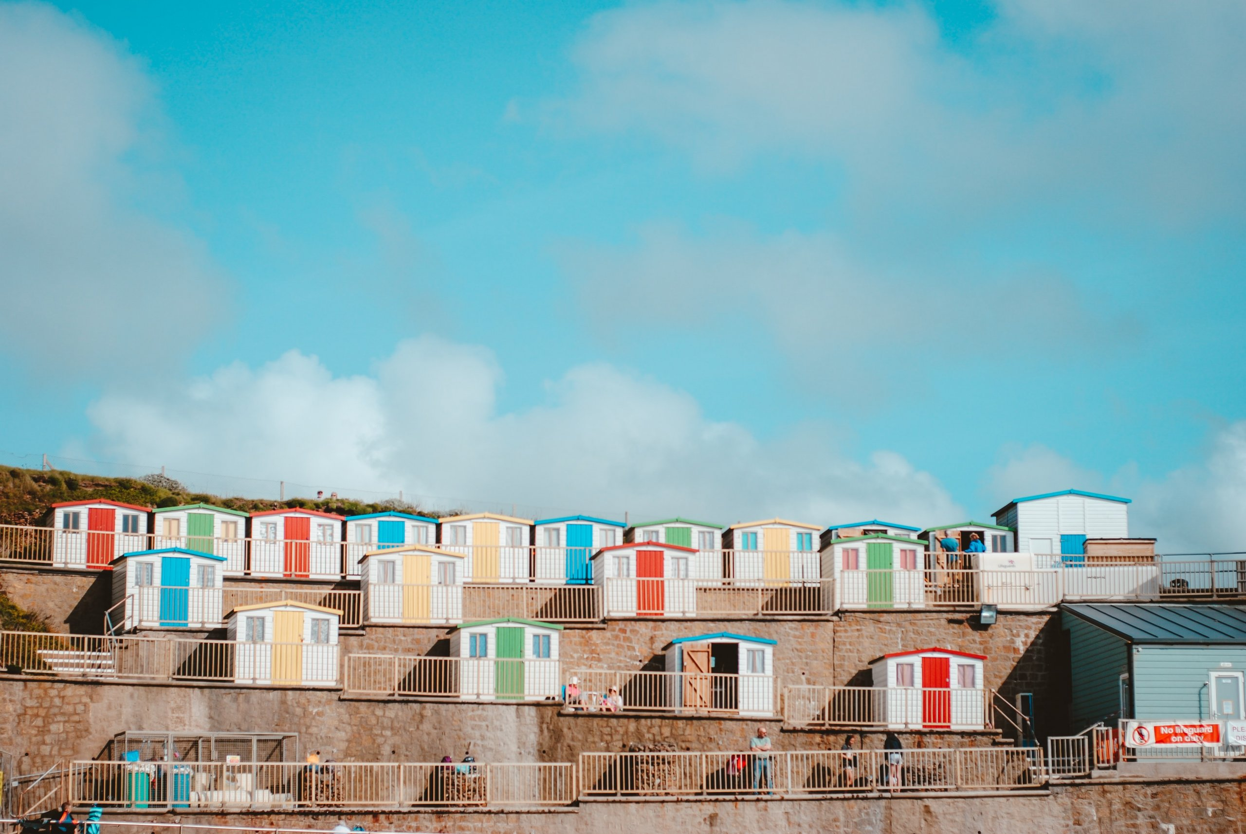 An image of colourful sheds
