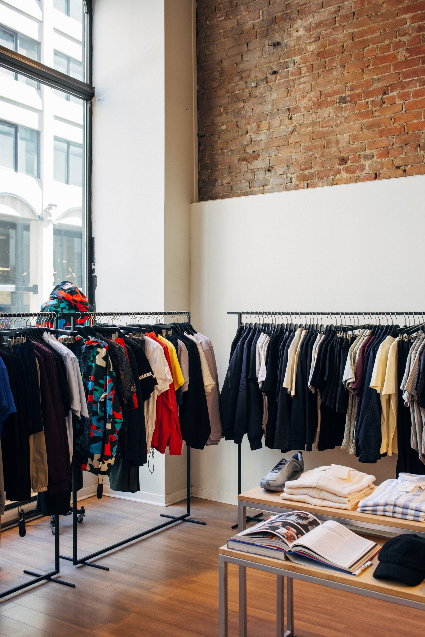 Retail shop with clothing on the rails
