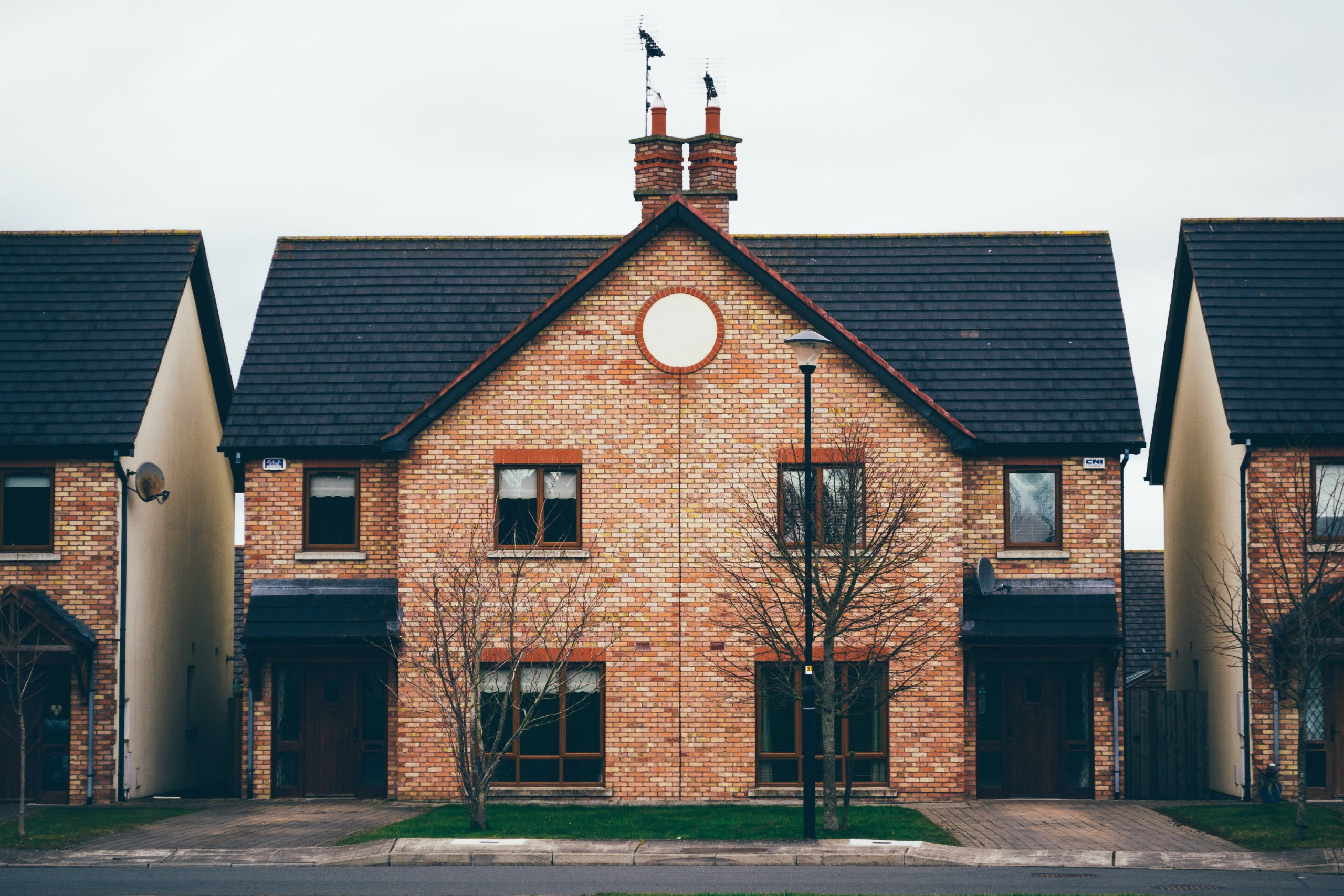 An image of a red brick modern semi detached home